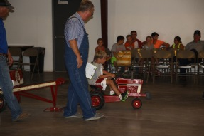 A Pedal Tractor Pull - We think a bigger tractor might have been helpful for this 6 yr old.